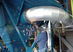 Sheet Metal Fabricator Greg Moyer installing Industrial Ventilation Duct at an Indiana manufactuing plant.